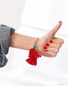 bracelet with red tassle